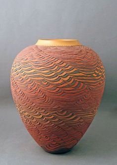 Show are created by the draped slab technique. It's the post fire reduction stage that produces the special appearance of raku pottery. The procedure ... http://zoladecor.com/20-ceramics-pottery-ideas-inspiration-april-2017