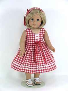 American Girl doll Kit is wearing a sleeveless dress with headband and bloomers that is perfect for a summer day.