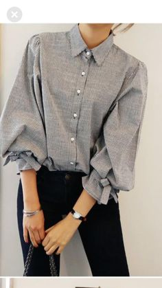 Button front mini stripe blouse with bow detail at sleeve. Cute!