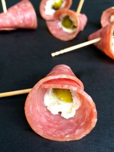 Pickles in a Blanket - A quick and easy snack or appetizer, these salty, savory, creamy bites of salami, herbed goat cheese and dill pickle are a big crowd pleaser.