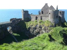 Dunluce Castle, N. Ireland, the castle by the sea.  First built In the 13th century, it is a now-ruined medieval castle in Northern Ireland. It is located on the edge of a basalt outcropping in County Antrim (between Portballintrae and Portrush), and is accessible via a bridge connecting it to the mainland. The castle is surrounded by extremely steep drops on either side, which may have been an important factor to the early Christians and Vikings who were drawn to this place where an early…