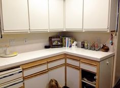 Easy way to update the 80's kitchen.  Paint the wood trim to match the cabinet fronts.