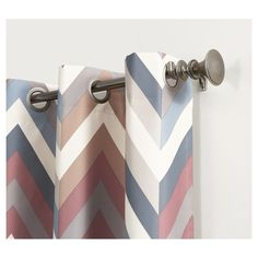 • 100% polyester construction<br>• Reduces heat and noise<br>• Energy efficient<br>• Room darkening<br>• Chevron pattern<br>• Includes 1 panel<br>• Machine washable for easy care<br><br>Block excessive heat and noise with the Sun Zero Calen Chevron-Printed Thermal-Lined Curtain Panel. This attractive panel does double duty by keeping your space dark and quiet, as well as adding a spl...