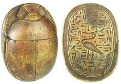 """Ancient Egyptian scarabs. Carved brown limestone heart scarab, once placed on the throat, chest, or heart of the Mummy. Some were worn by the deceased on a necklace, or mounted in gold settings as a pectoral. Heart scarabs provided the bearer with the assurance that at the final judgment as depicted in the Book of the Dead, the bearer would be found """"True of Voice"""" and accepted into the eternal afterlife by the God Osiris. At the bottom, hieroglyphics and Egyptian symbols including a bird."""