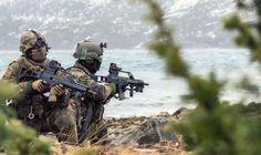 """German Bundeswehr Fallschirmjäger during NATO war game """"cold response 2014″ in Norway."""