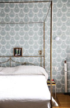 traditional bedroom with scallop wallpaper