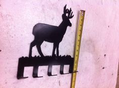 BUCK in GRASS metal hat rack about 12 inches tall $20
