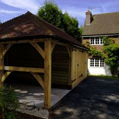 Sustainably sourced oak framed garages from Hamlet Buildings Ltd. Traditional and contemporary oak garage styles for all budgets and tastes. Garden Structures, Garage Ideas, Garages, Cabin, Traditional, Contemporary, House Styles, Building, Frame