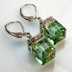 Short drop peridot green Swarovski crystal earrings are combined with sparkly rhinestones. Accented with a clear crystal on top. Handmade with sterling