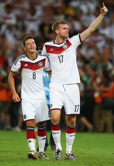 Mesut Oezil and Per Mertesacker of Germany celebrate after defeating Argentina 1-0 in extra time during the 2014 FIFA World Cup Brazil Final match between Germany and Argentina at Maracana on July 13, 2014 in Rio de Janeiro, Brazil.