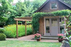 A Garden Tour With a Guest Cottage - Who says you have to have a big yard and exotic plants to create a garden oasis? This city lot uses regular garden center f…