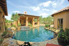 Covered Patio - The Spanish flavored architecture of the home is mirrored in the poolside casita, which houses a lovely dining area with a beautiful view across the water. Photo courtesy of Master Pools Builder: Keith Zars Pools http://www.luxurypools.com/builders-designers/master-pools-guild-inc.aspx