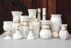 Shabby chic off white painted vases, with burlap, lace and creamy white paper flowers... a very elegant yet softly rustic and shabby look! This listing is for a set of 12 assorted vases, with a few more of our larger sizes than some other sets. The creamy white flowers on the off white vases look very soft and neutral. Need some additional accent tealight/votive holders? See this other listing in our shop https://www.etsy.com/listing/185939712/shabby-chic-mason-jars-in-off-white-for,...
