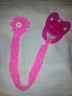 pink crochet pacifier holder with button flower