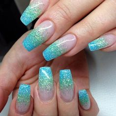 40 Mermaid Acrylic Nails On Trend This Year why not to go for a nail art that portrays sea and a sea creature like mermaid who is almost everyone's favorite mystical creature. Mermaid nails refer to any nail enhancement or gel service with a thin layer of Glitter Gradient Nails, Glitter Nail Art, Blue Glitter, Blue Nails, Gel Nails, Acrylic Nails, Ombre Nail, Coffin Nails, Nail Art Designs