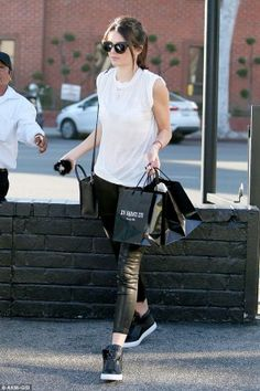 Kendall Jenner wearing Celine Nano Bag, Quay Modern Love Sunglasses and Versace Pallazzo High-Top Trainers