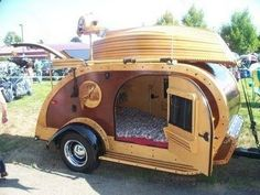 DIY teardrop camper. Like the boat/canoe that matches.