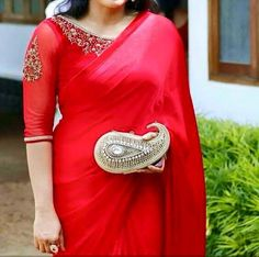 Pretty simple red saree and statement blouse. Love the statement paisley shaped clutch! To order WhatsApp on 9703713779 Blouse Back Neck Designs, Silk Saree Blouse Designs, Saree Blouse Patterns, Kurta Designs, Blouse Designs Catalogue, Net Blouses, Blouse Models, Elegant Saree, Beautiful Blouses