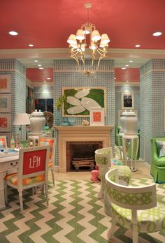 I don't know who would actually have this room in their house, but it sure is fun! love the playful colors and the raspberry chair back monogram