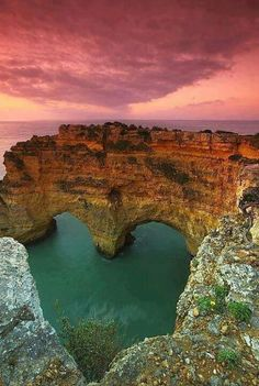The photo above features the Heart Sea Arch in Portugal. Although the sea isn't really heart-shaped, the natural heart photography makes it a must-visit place in Portugal. Places Around The World, Oh The Places You'll Go, Places To Travel, Around The Worlds, Beautiful Places To Visit, Beautiful World, Amazing Places, Amazing Things, Beautiful Scenery