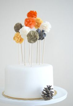 Pom poms for the cake...maybe some napkin rings too?? Bridal shower idea...