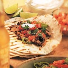 Fajitas make a quick-and-easy midweek dinner. Combine the beef and marinade the night before, then you need only assemble the condiments and saut& the meat just before serving. Let your guests garnish and wrap their own fajitas. Mexican Dishes, Mexican Food Recipes, Ethnic Recipes, Mexican Spice, Chili's Fajitas Recipe, Tamales, Quesadillas, Empanadas, Enchiladas