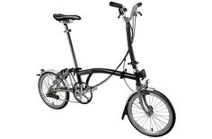 #Brompton H6L Superlight 2017 Folding Bike > Black #Brompton™s Superlight takes their proven formula and turns it up to 11. Without removing any of the functionality of their popular design, Brompton removes some of the heavy steel parts and replaces them with superlight titanium and aluminium parts. This means a weight saving of 700 grams over a standard model and thanks to the raw titanium finish the Superlight not only rides great but is immediately recognisable.