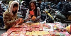 26 beautiful photos from Lunar New Year celebrations around the globe: People shop for red envelopes that hold the lucky-money that is traditionally given to relatives and friends.