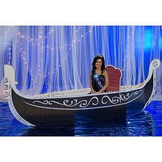 This silver and black 4 feet high x 13 feet long x 3 feet deep cardboard Venetian Sky Gondola is perfect for creating a romantic photo setting.