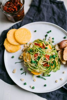 Spiralized Zucchini Pasta with Garlic Peas and Polenta