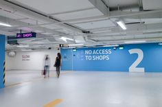 Sensational Stylish Car Park Designs: Light Blue Color Combined With White Flooring Unit In Appealing Car Park Decorating Ideas