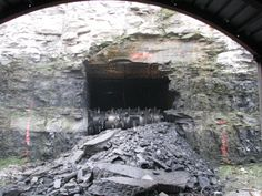"""The extraction end of a continuous mining machine, the miner head which extracts coal from the working face of an underground coal mine. In this photo, the mine has """"punched out"""" by mining the coal seam to the surface outcrop of the seam to create another entry to the mine"""