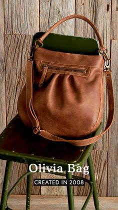 Our Olivia Bag is an iconic Roots style reissued from our archives. Designed and handcrafted in Canada, its classic silhouette features a top magnetic closure, zipper front pocket, interior pockets, a leather handle and an adjustable shoulder strap. Leather Handle, Leather Bag, Roots, Shoulder Strap, Canada, Closure, Silhouette, Zipper, Pockets