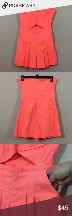 Hollister Neon Orange Strapless Romper Sweetheart neckline, cut out in the middle, pockets, rubber Detail around Top to keep it up, side zipper, shorts, new without tags, never worn Hollister Pants Jumpsuits & Rompers