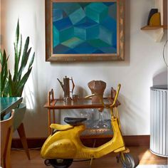 Love the mid century modern painting and other unique touches in this eclectic modern home!