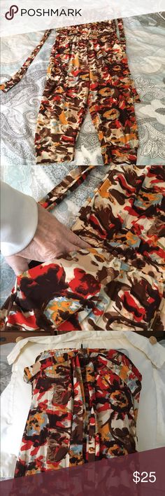 Darling NEW Jumpsuit/Romper from Jamaica Great colors...Capri length, elastic waistband ... strapless, can be tied 2 + ways.. small to medium fit. Never worn... great for beach or summer wear Handmade in Jamaica Other