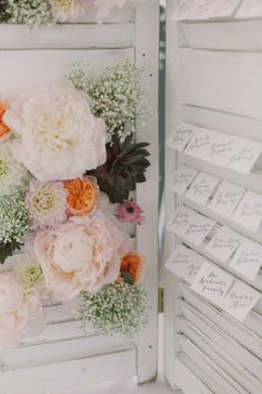 White Shutter Escort Card Display. we dont have the flowers, but we can use some greenery and the mini white buckets with babys breath