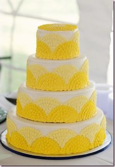 Yellow Wedding Cake. I'd prob. use a diff. color, but like the design. The color isn't bad- just not what I want for a color scheme.