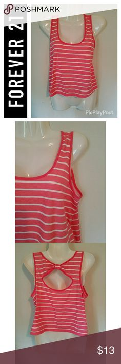 Forever 21 Striped Bow Back Crop Top Excellent used condition. Forever 21 brand pink and white striped cropped tank top with open bow back detail. Cute and casual. Forever 21 Tops Crop Tops