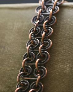 Copper Handmade wire wrapped link Bracelet Antiqued patina to define those curls, hand-buffed and sealed with renaissance wax I have made a few