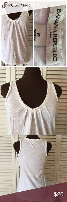 Beautiful white 100% cotton Tee This is White with little cotton like balls around neckline.  Like NWOT.  I also have a Cobalt Blue in my closet as well as a White Shrug,  and Black Shrug same sizes and Materials.  Be sure to check them out. Banana Republic Tops Tank Tops