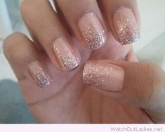 Nude and silver glitter nail art