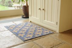 """Dirt Trapper Gripper Washable Design Mat approx 23"""" x 33"""" - Fleur de Lys by Cotswold Mat Co Ltd. $64.95. Machine washable at only 40°C and tumble dryable.. Approximate thickness 7mm. Dimpled gripper backing to grip hard floors and give additional grip on carpets. 5 year guarantee. Made in the UK.. 100% cotton pile to absorb 95% on wet and mud. Ideal for doorways, kitchens, bathrooms, boats and especially pets. Made in the UK using a cotton rich pile which absor..."""