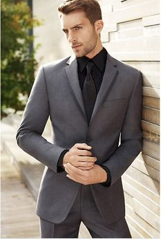 Grey suit. Black shirt & tie.