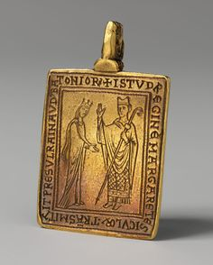 Reliquary Pendant with Queen Margaret of Sicily Blessed by Bishop Reginald of Bath  Date: 1174–77 Geography: Made in Canterbury, England Culture: British Medium: Gold Dimensions: Overall: 1 15/16 x 1 1/4 x 1/4 in. (5 x 3.1 x 0.7 cm) Classification: Metalwork-Gold