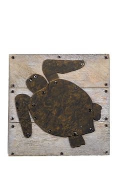 This rustic turtle plaque is the perfect addition to any beach-inspired space.