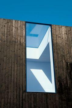 Adjaye cut a gap straight through the roof and facade.