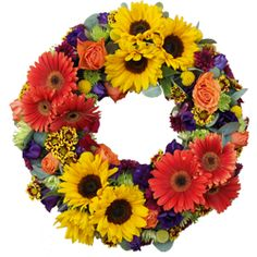 This vibrant wreath is resplendent with colourful sunflowers, gerberas, roses and lizianthus.