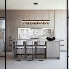 Our Baylor counter stools in this fabulous modern kitchen. Kempf and Co. Photo: Danya Maclean and Wise Nadel Design Metallic Painted Furniture, Metal Furniture, Modern Counter Stools, Bar Stools, Wholesale Furniture, Online Furniture, Rooster Decor, Boutique Homes, Grey Kitchens