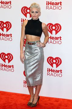 Miley Cyrus shows off her fab abs at the iHeart Radio Music Festival at MGM Grand Resort in Las Vegas, Nevada on September 21, 2012.